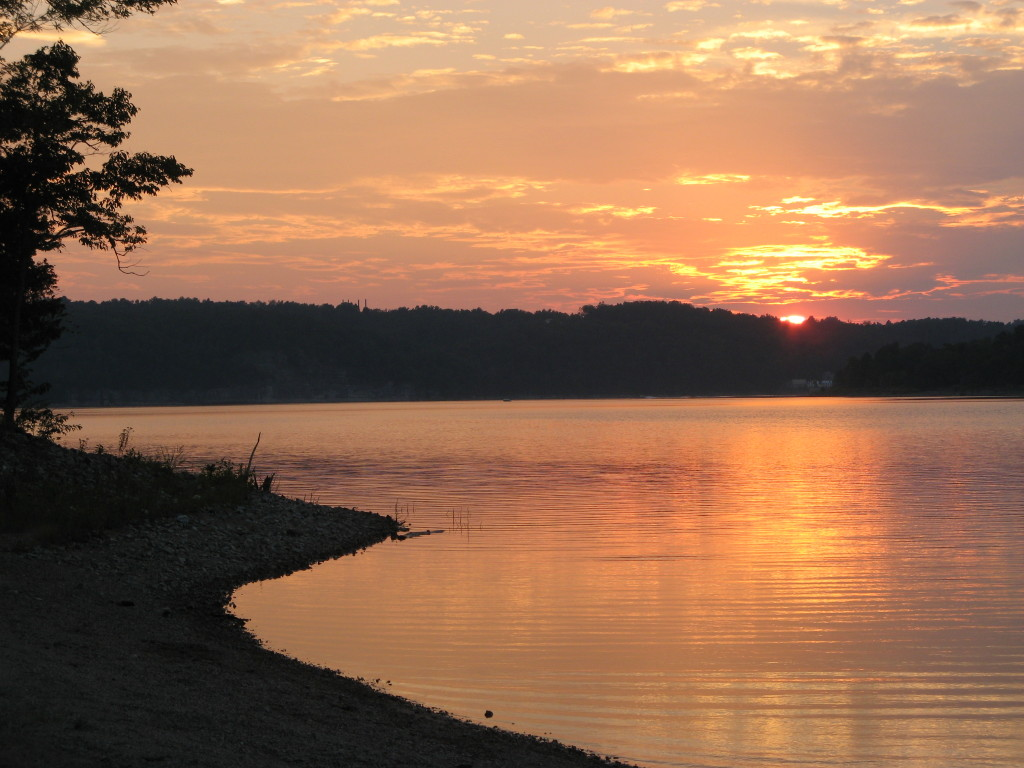 Peach colored sunset at lake
