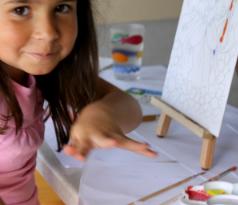 Smiling child artist
