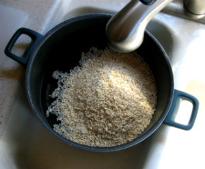 Water being added to a pot of rice