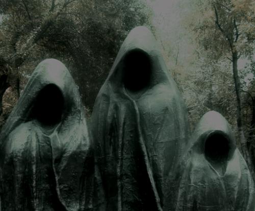 Three robed presences