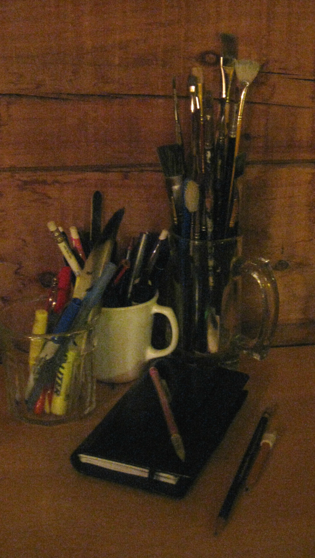 Pens, pencils and notebook